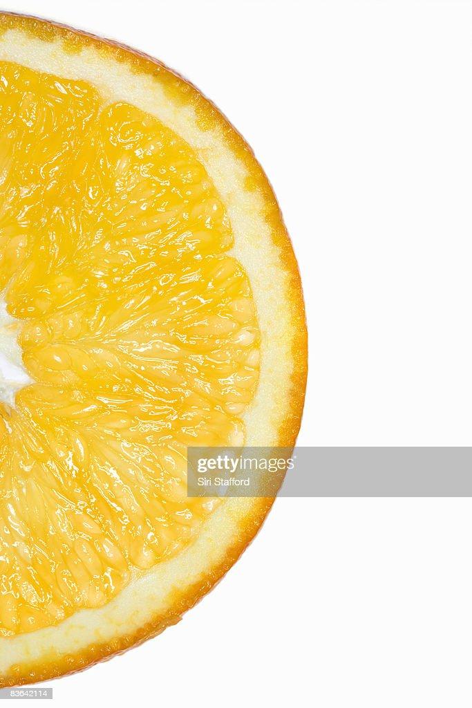 sliced orange on white : Stock Photo