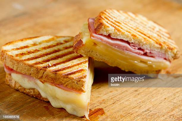 Sliced panini sandwich on wood surface