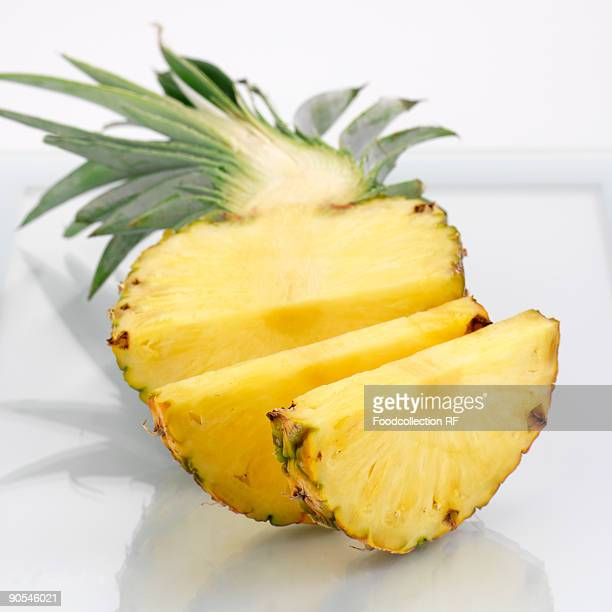 Sliced pineapple on white background, close up