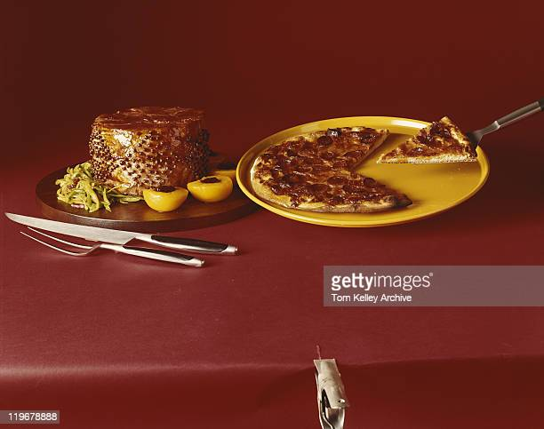 Sliced pizza and sweet dessert on red background