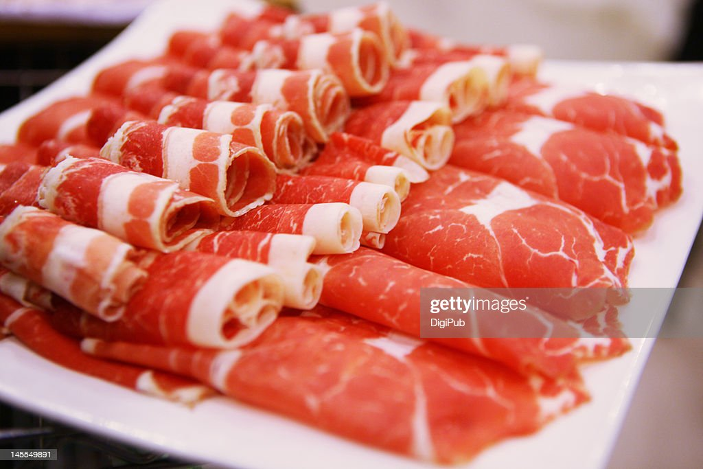 Sliced raw beef : Stock Photo
