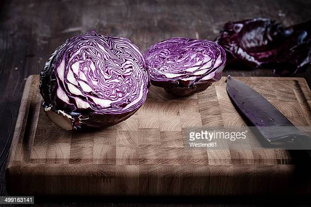 Sliced red cabbage on chopping board and knife