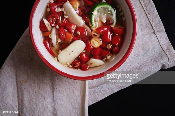 Sliced red chili pepper in fish sauce