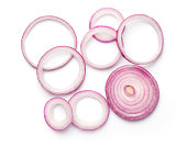 Sliced red onion rings isolated on white background. Top view