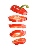 sliced and falling red pepper isolated on white background