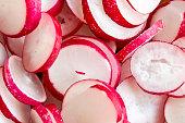 sliced red radishes closeup shot