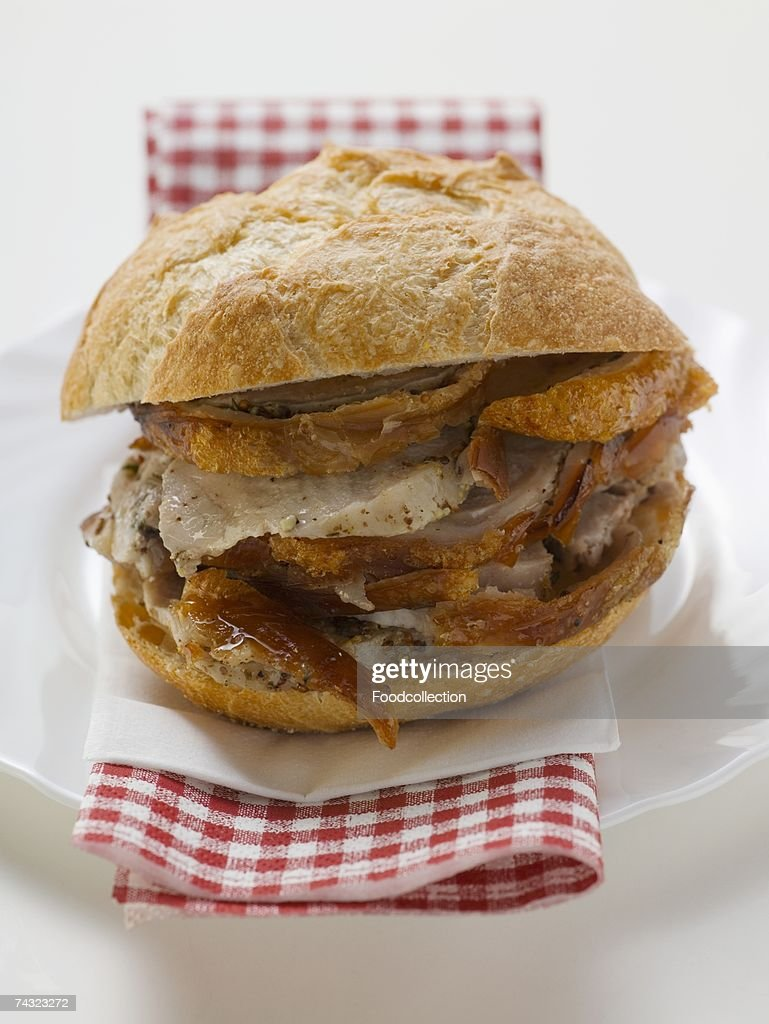 Sliced roast pork in a roll : Stock Photo