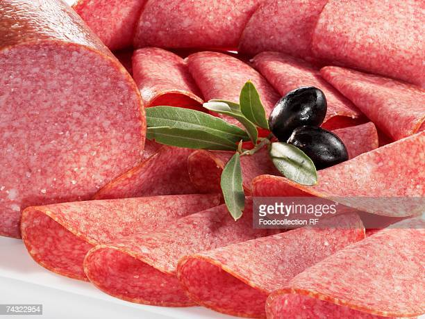 Sliced salami and olives