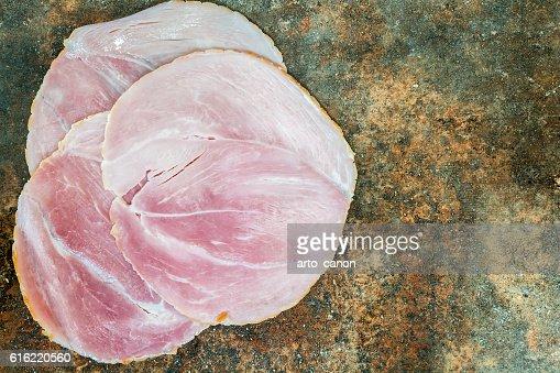 Sliced smoked ham on stone background : Stock-Foto