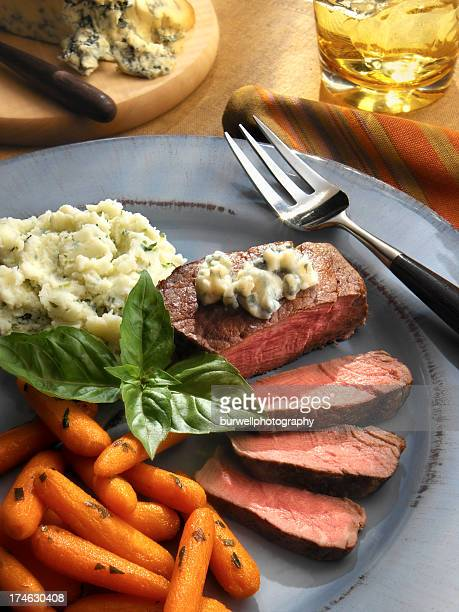 Sliced steak with mashed potatoes and carrots