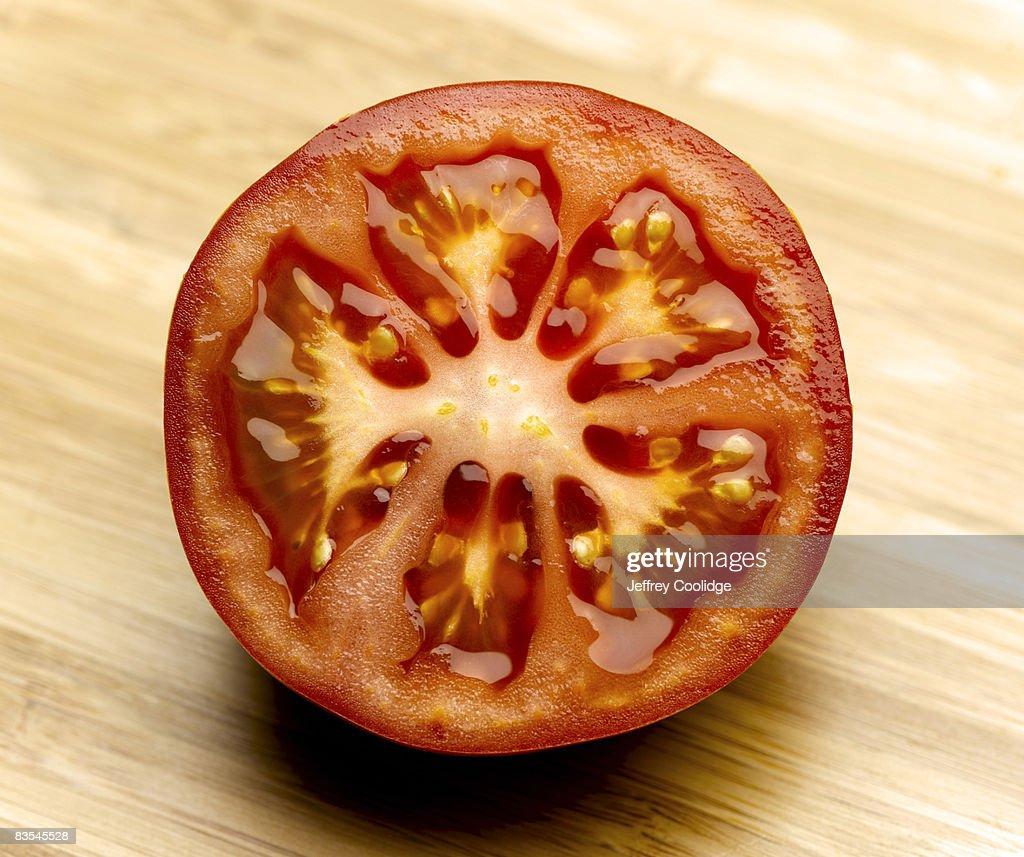 Sliced tomato on cutting board : Stock Photo