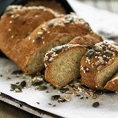 Sliced whole grain bread on board