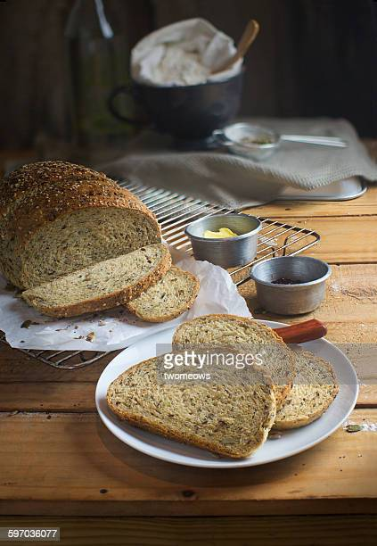 Sliced whole grain bread on wooden background