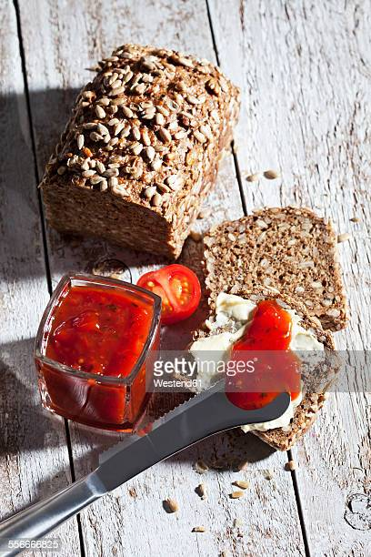 Slices of bread and glass of tomato jam