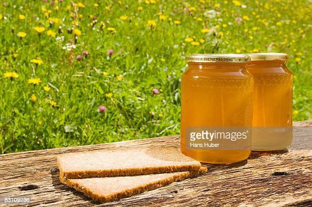 Slices of bread and jar of honey, close-up