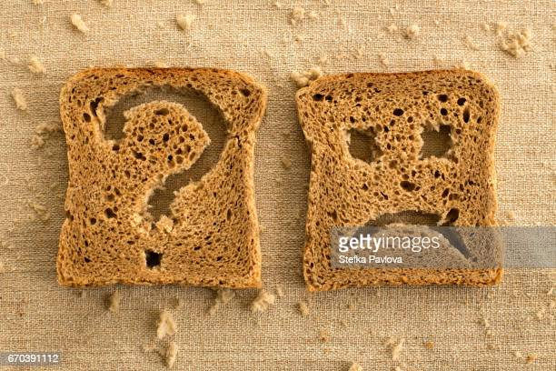 Slices of bread toast with a sad face and question mark