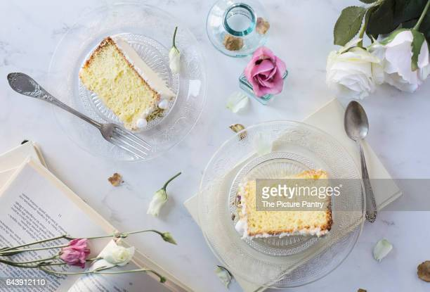Slices of chiffon cake on marble table