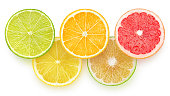Slices of citrus fruits isolated on white background with clipping path