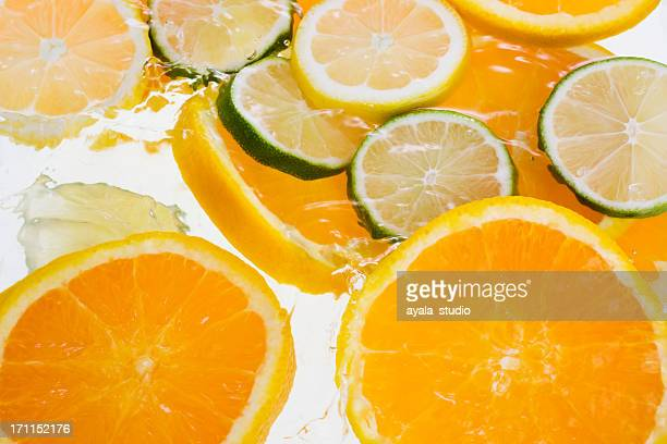 Slices of citrus fruits with water
