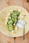 Slices of cucumber, Yoghurt, Dill and Herder's cheese on wrap