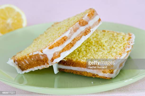 Slices of home made iced lemon cake on plate