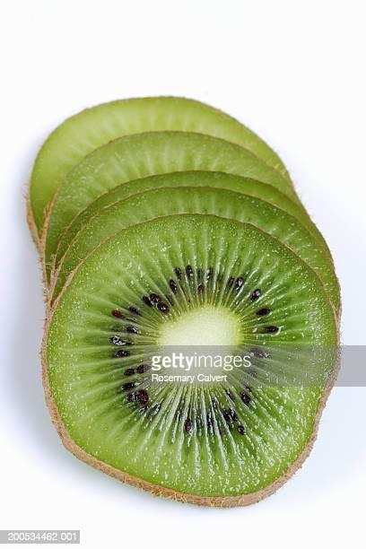 Slices of kiwifruit, against white background, close-up