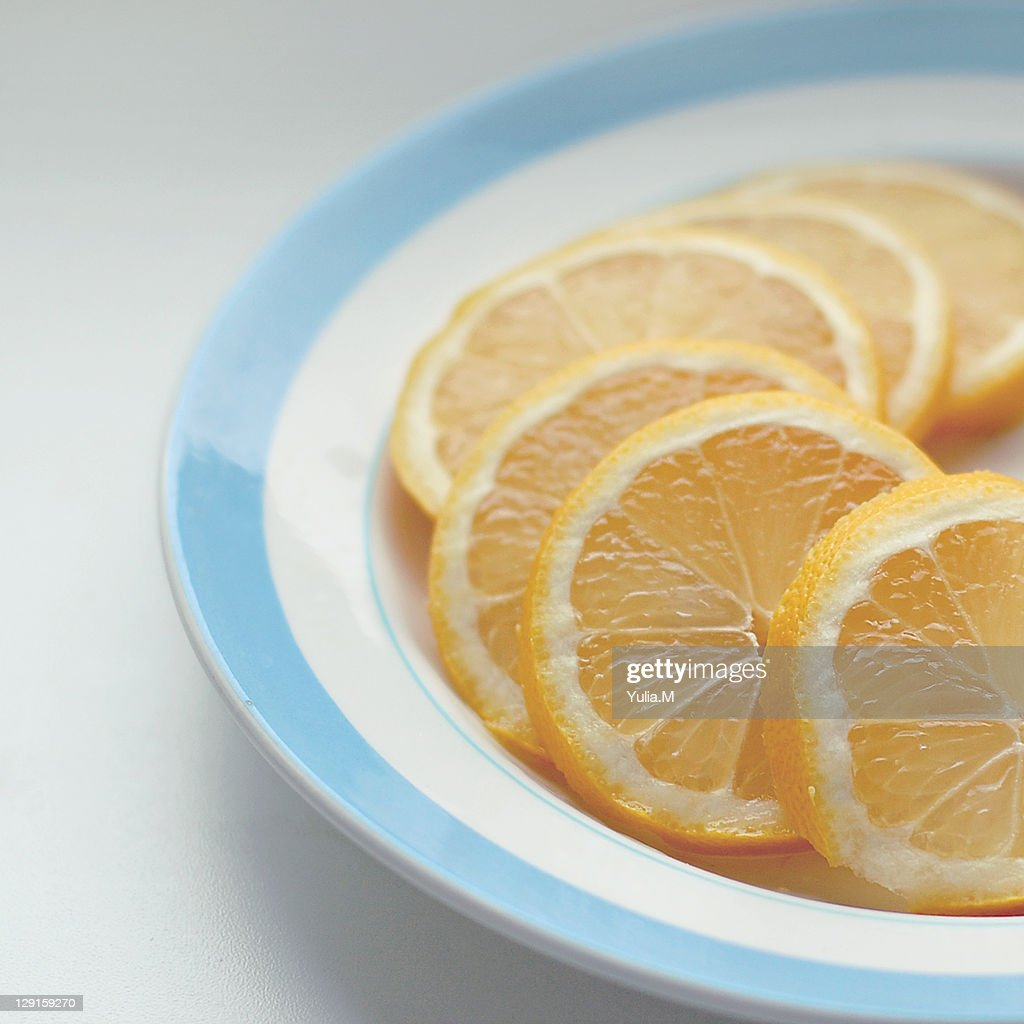 Slices of lemon on plate : Stock Photo