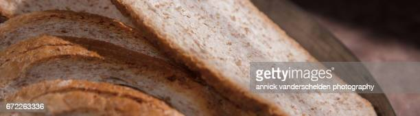 Slices of old brown bread.