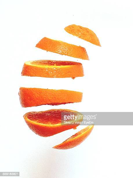 Slices Of Orange Against White Background