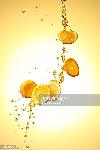 Slices of oranges in the air