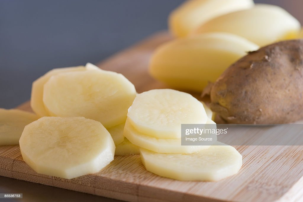 Slices of raw potato : Stock Photo