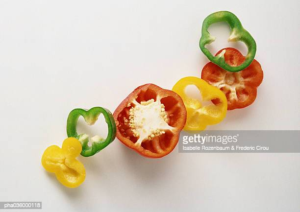 Slices of red, yellow and green bell peppers
