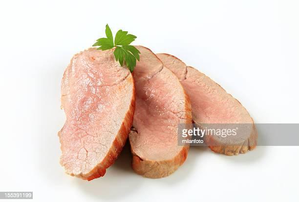 Rodajas de cerdo asado