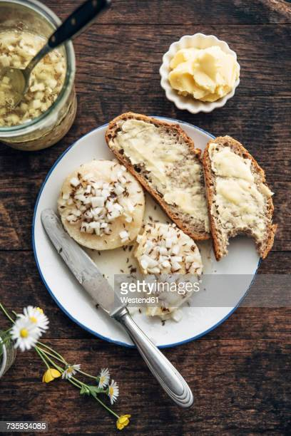 Slices of rye bread, Harzer Roller cheese with onions and caraway on plate