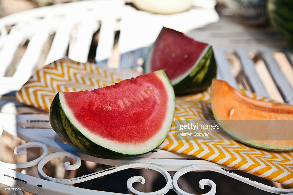 Slices of watermelon and canteloupe on table : Stock Photo