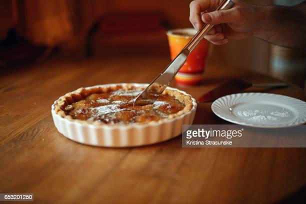 Slicing an apple pie