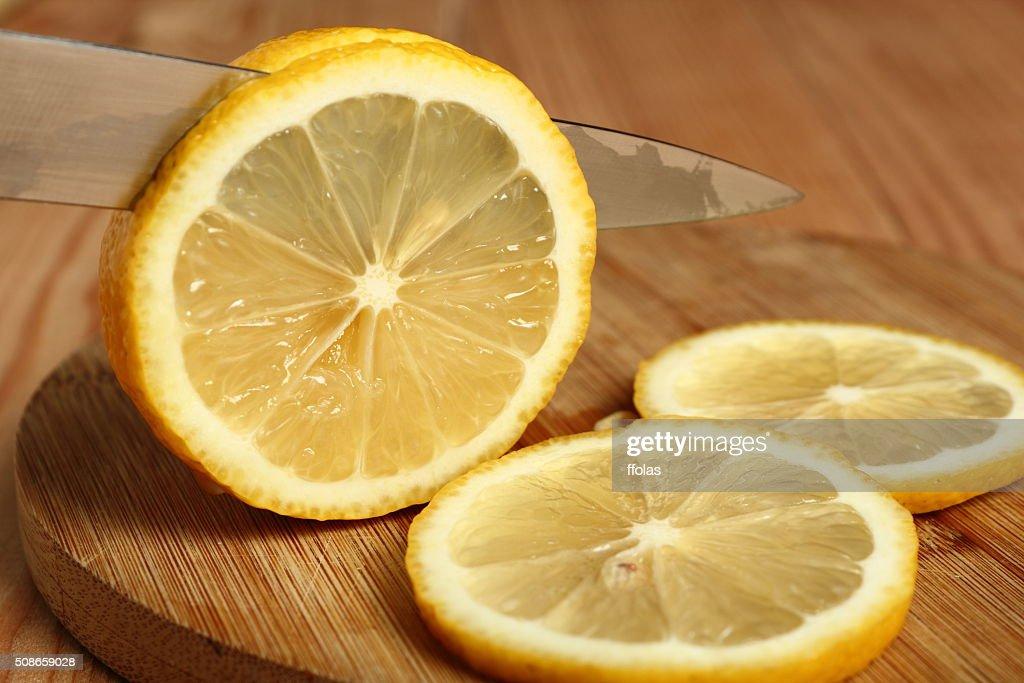 Slicing lemon : Stock Photo
