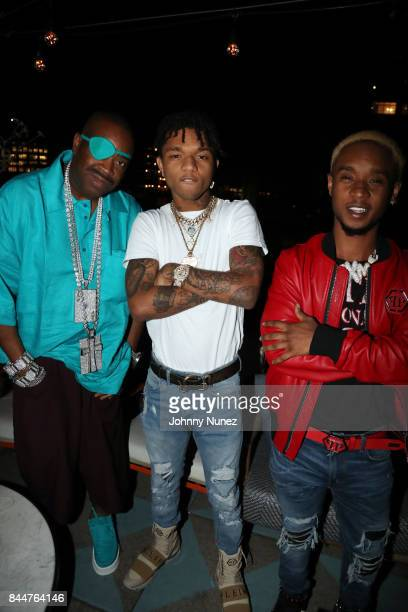 Slick Rick poses with Swae Lee and Slim Jxmmi aka Rae Sremmurd at the Future x Flaunt x Reebok Celebration of 'The Eternal Issue Beyond Monuments' at...