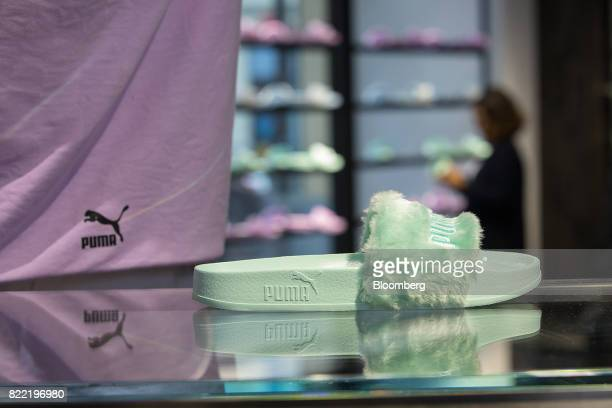 A slider designed by singer Rihanna sits on display of a Puma SE sportswear clothing store in Berlin Germany on Tuesday July 25 2017 Puma increased...
