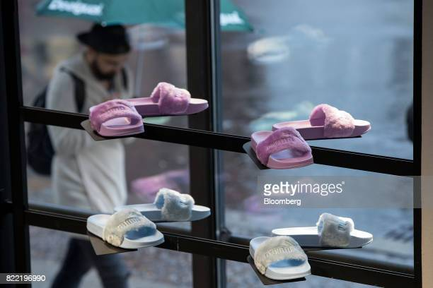 Sliders designed by singer Rihanna sit in the window display of a Puma SE sportswear clothing store in Berlin Germany on Tuesday July 25 2017 Puma...