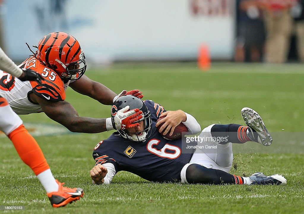 Sliding after running 18 yards for a first down, <a gi-track='captionPersonalityLinkClicked' href=/galleries/search?phrase=Jay+Cutler&family=editorial&specificpeople=622249 ng-click='$event.stopPropagation()'>Jay Cutler</a> #6 of the Chicago Bears is grabbed by the head by <a gi-track='captionPersonalityLinkClicked' href=/galleries/search?phrase=Vontaze+Burfict&family=editorial&specificpeople=7173056 ng-click='$event.stopPropagation()'>Vontaze Burfict</a> #55 of the Cincinnati Bengals at Soldier Field on September 8, 2013 in Chicago, Illinois. The Bears defeated the Bengals 24-21.