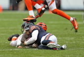 Sliding after running 18 yards for a first down Jay Cutler of the Chicago Bears is stepped on the head by a Cincinnati Bengal defender at Soldier...