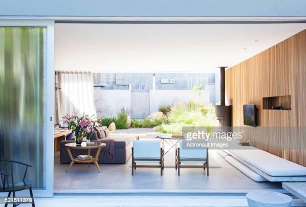 Sliding glass door opening to modern living room