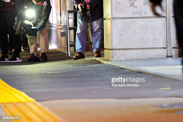 A slight gradation on the sidewalk is seen in front of JR Hakata Station early in the morning after the ground started sinking again on November 26...