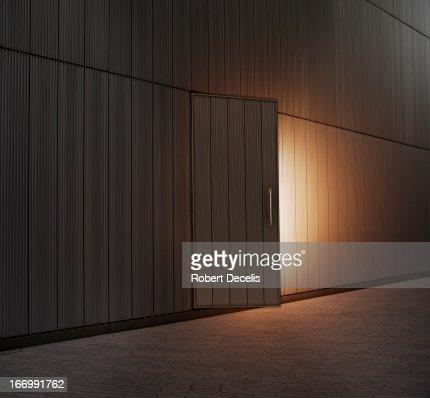Slightly open door lit from within