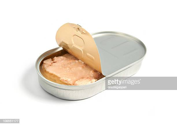 A slightly opened tin of pink salmon