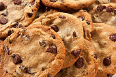 Slightly overdone chocolate chip cookies in a messy pile
