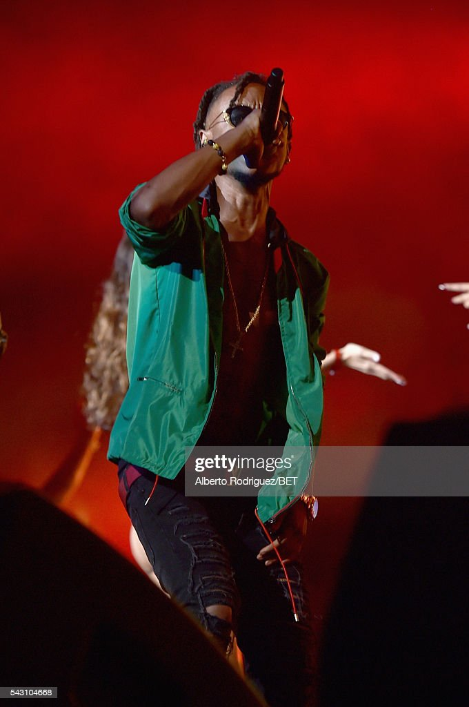 Guest performer <a gi-track='captionPersonalityLinkClicked' href=/galleries/search?phrase=Slim+Jimmy&family=editorial&specificpeople=12935151 ng-click='$event.stopPropagation()'>Slim Jimmy</a> of Sremmurd performs onstage with recording artist Ty Dolla $ign during the 2016 BET Experience at Staples Center on June 25, 2016 in Los Angeles, California.