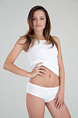 Slim woman showing her stomach