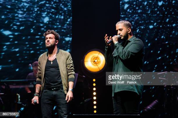 Slimane and Claudio Capeo perform during Leurs Voix pour l' Espoir at L'Olympia on October 12 2017 in Paris France